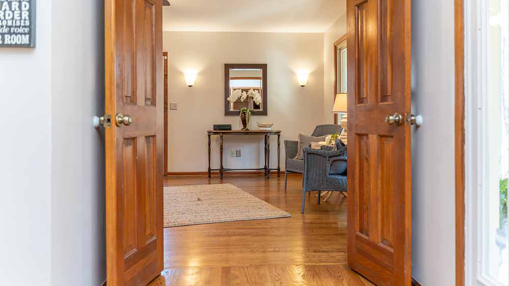 whippoorwill double doors from foyer to main level master suite