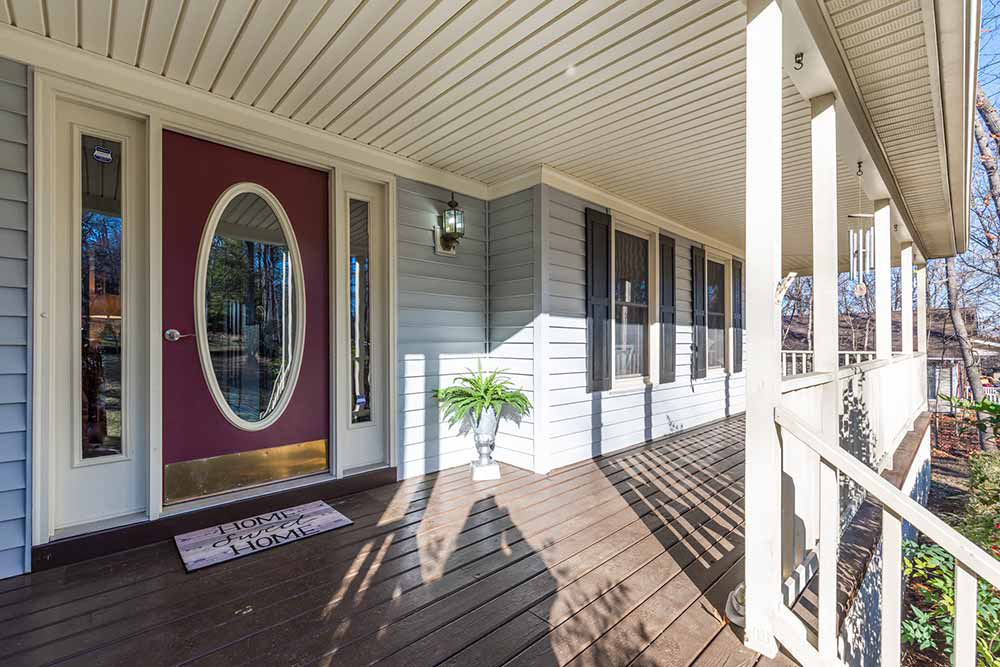 whippoorwill front door and wraparound trex porch