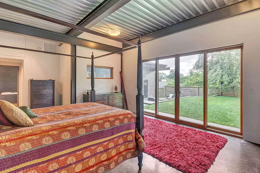 cotw modern coolness master bedroom looking out double sliding glass doors