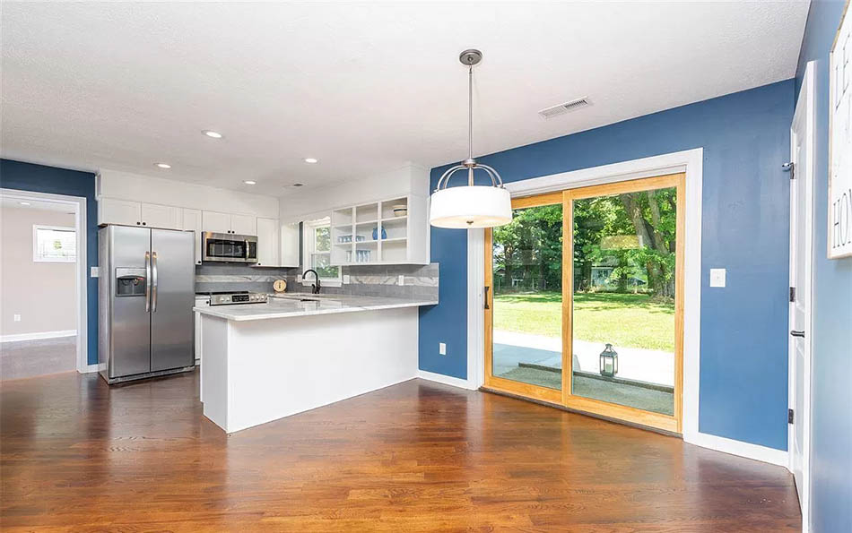 luxury in lyndhurst kitchen and dining area with sliding doors to patio