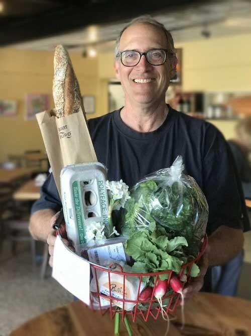 An organic mood boost! Local Food Drive Through has a wide variety of local food and produce available for pickup twice a week at Newtown Baking
