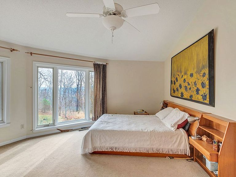 cotw around around, round top bedroom with huge windows and gorgeous view