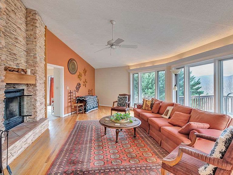 cotw around around, round top living room and stone fireplace