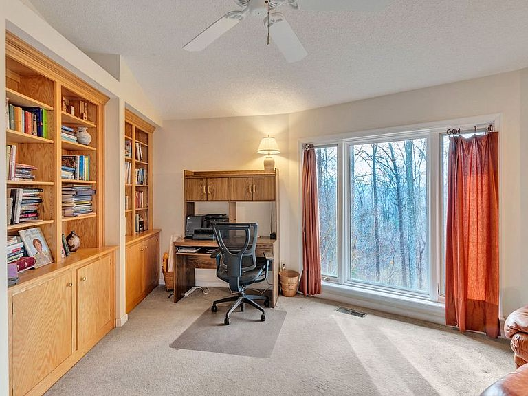 cotw around around, round top office with built-in bookcases and view