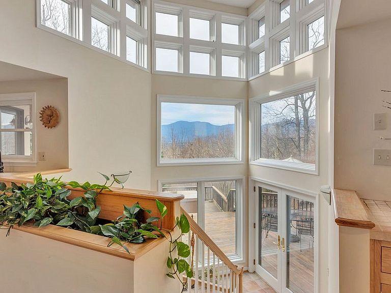 cotw around around, round top three stories of window and mountain views