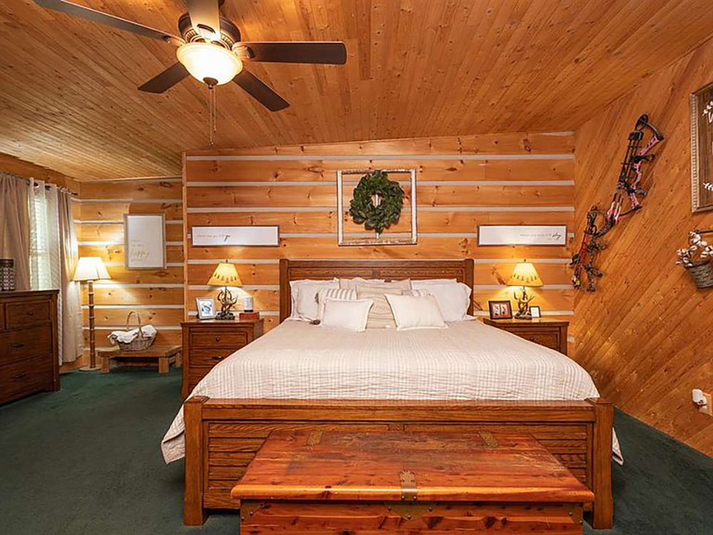 cotw modern rustic log cabin paneled bedroom with view of seating area