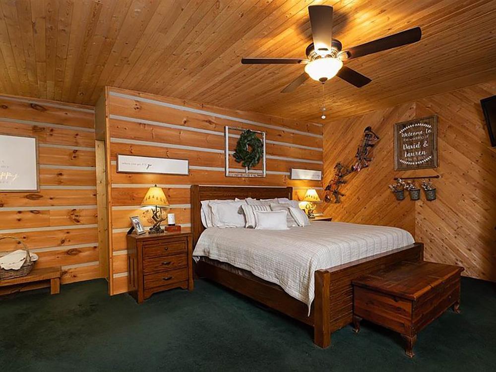 cotw modern rustic log cabin paneled master bedroom