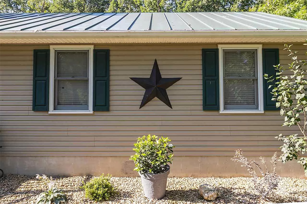 cotw modern rustic metal roof and tin star