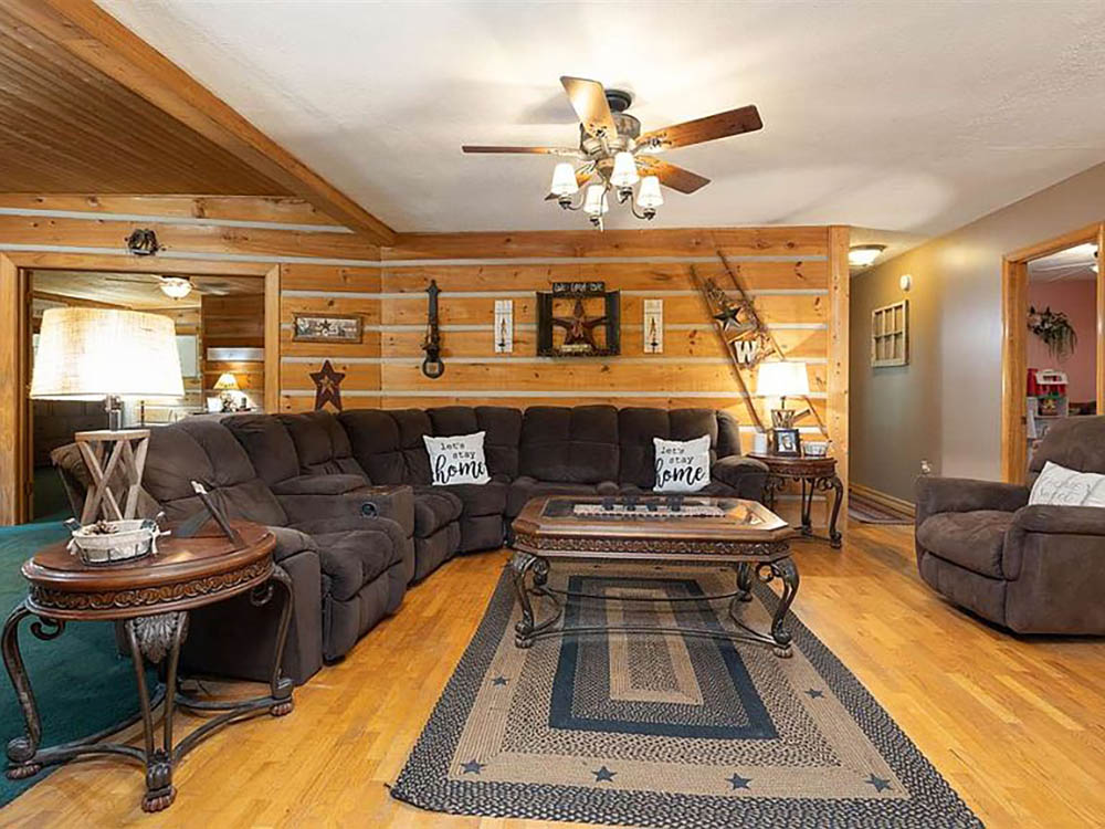 cotw modern rustic wood paneled living room and hallway