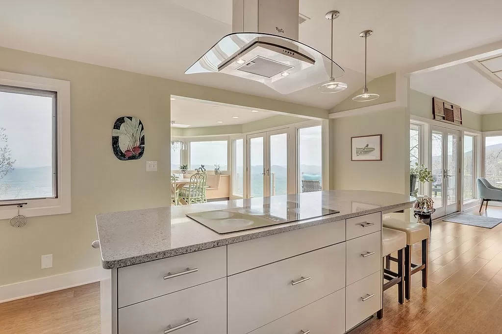 cotw mountain mama mia kitchen island with modern vent over cooktop