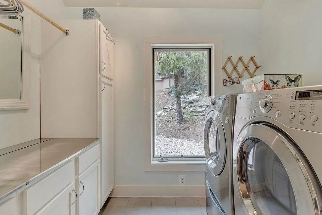 cotw mountain mama mia large laundry rom with cabinets