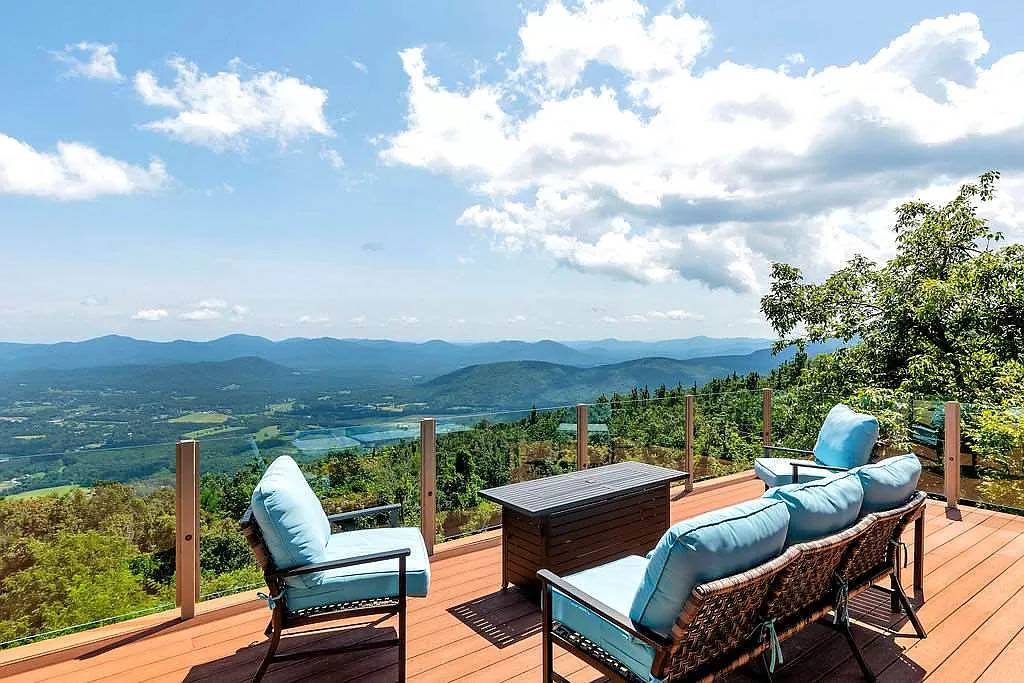 cotw mountain mama mia rear deck with amazing mountain view and glass panel fence