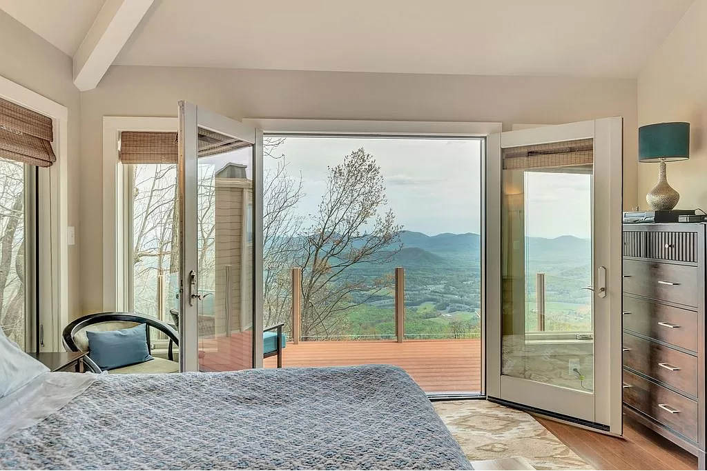 cotw mountain mama mia the view to the back deck from the master bedroom