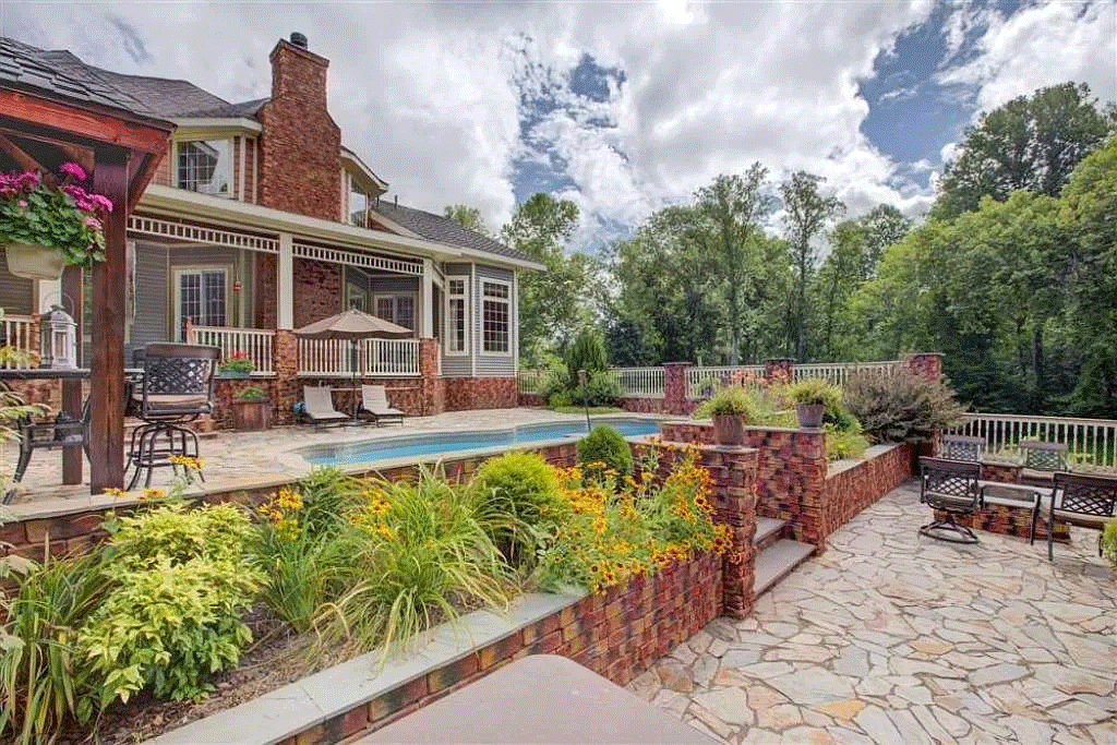 cotw victorian secret backyard-stone-patio-in-ground-pool-cabana-and-large-back-porch