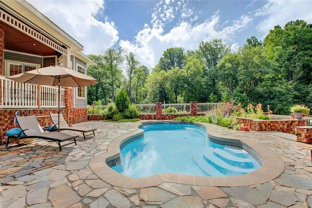 cotw victorian secret in-ground-pool-with-scalloped-edges-and-stone-decking