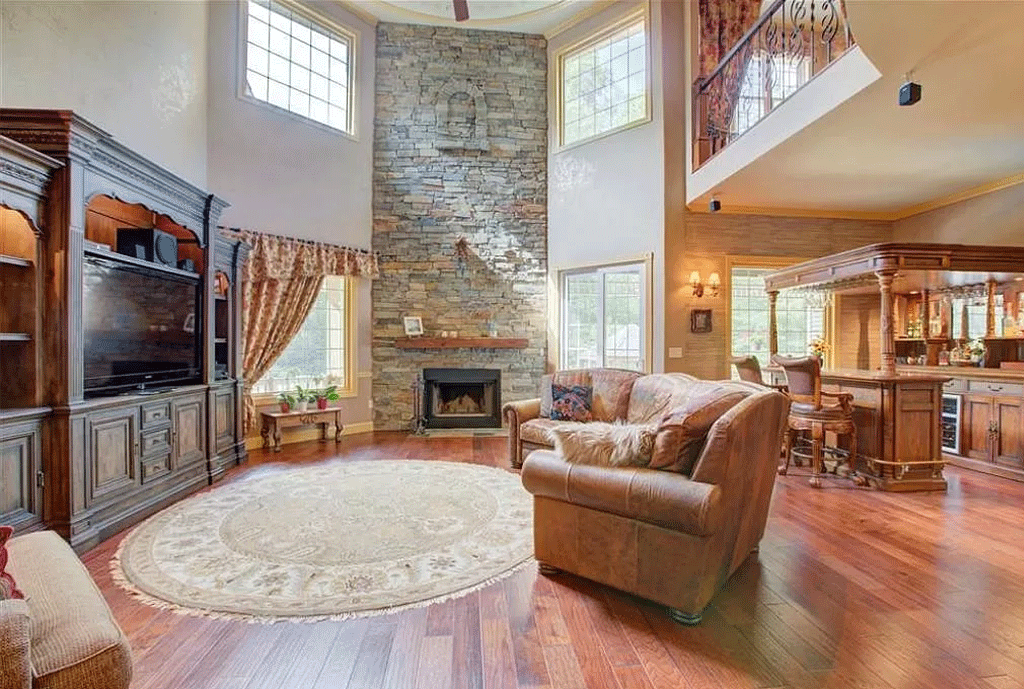 cotw victorian secret iving-room-with-2-story-stone-fireplace-and-bar