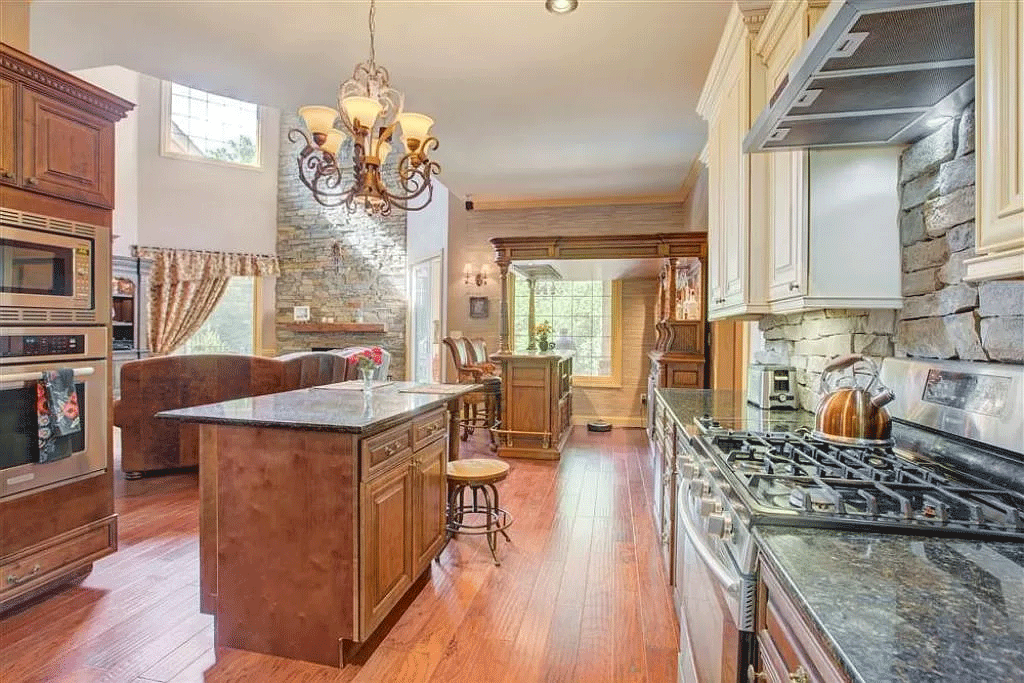 cotw victorian secret kitchen-with-sone-walls-and-marble-counters-and-island