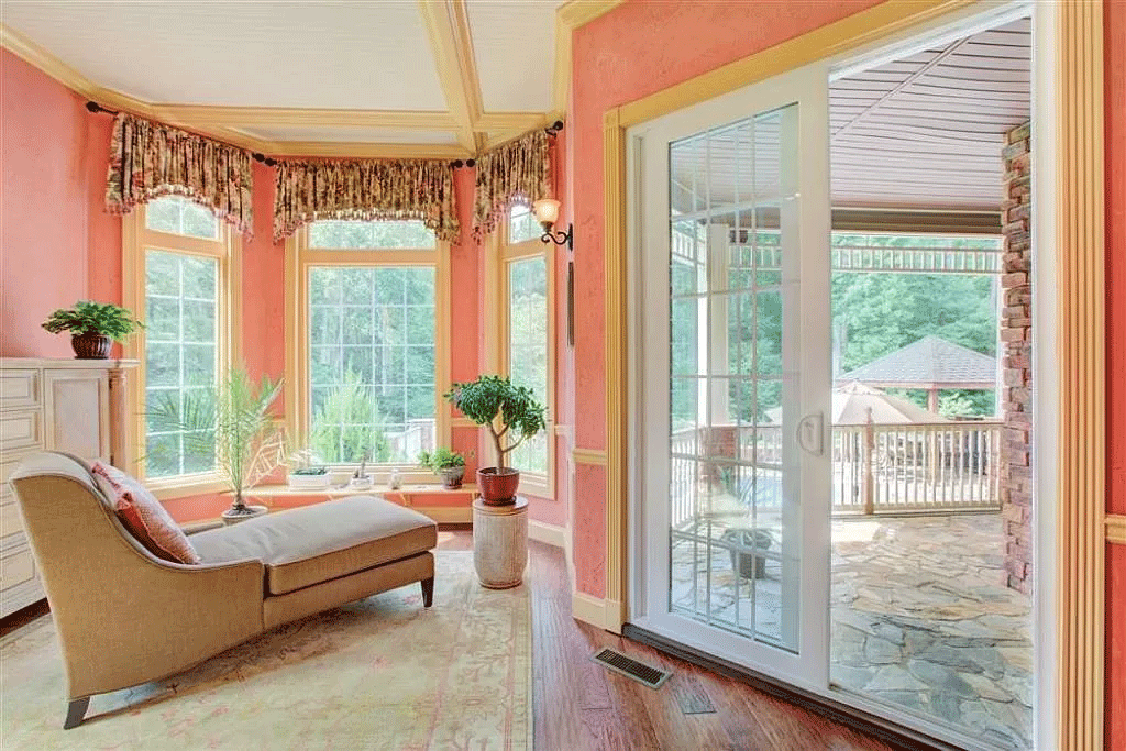 cotw victorian secret master-bedroom-seating-area-with-bay-window-and-glass-doors-to-stone-balcony