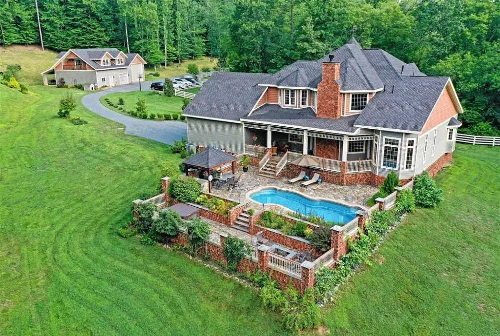 cotw victorian secret rear-view-of-home-with-pool-and-patio-second-garage-in-distance