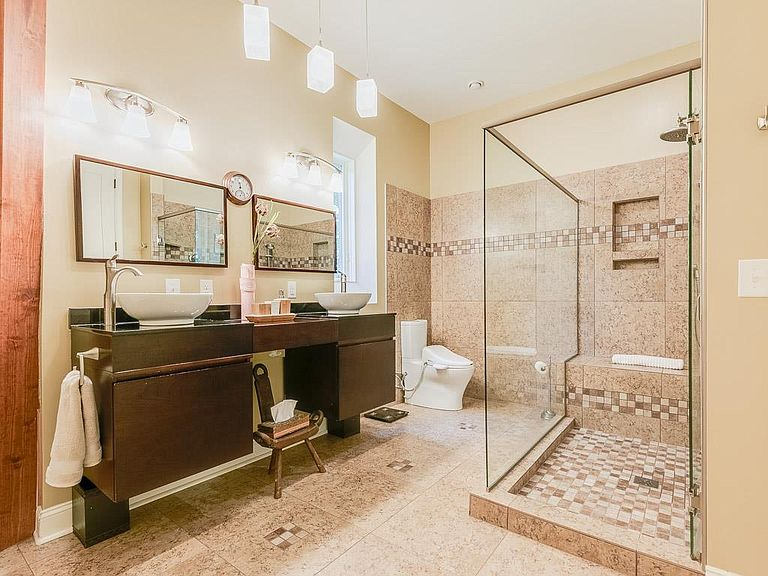 cotw welcome to the octagon spa bath with modern vanities and glass enclosed shower