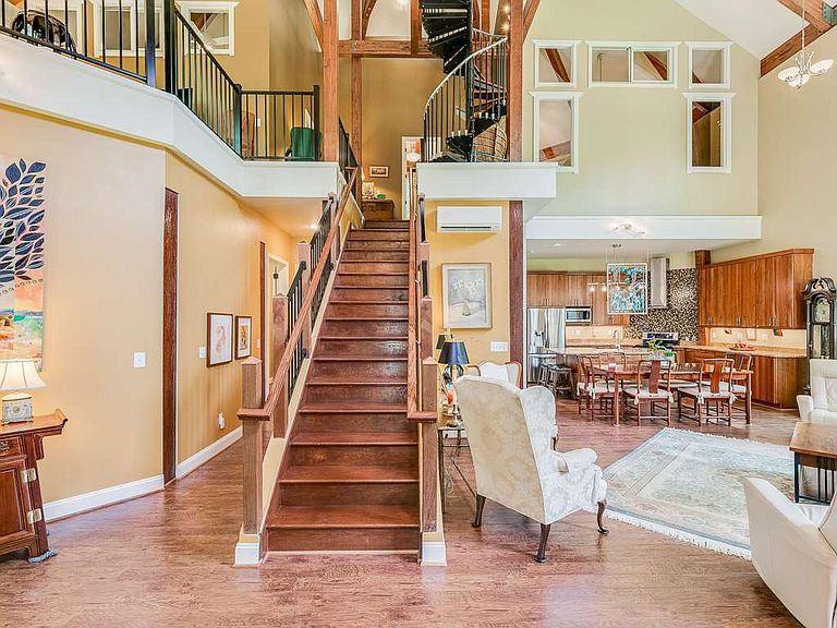 cotw welcome to the octagon central stairway with view from living area to kitchen