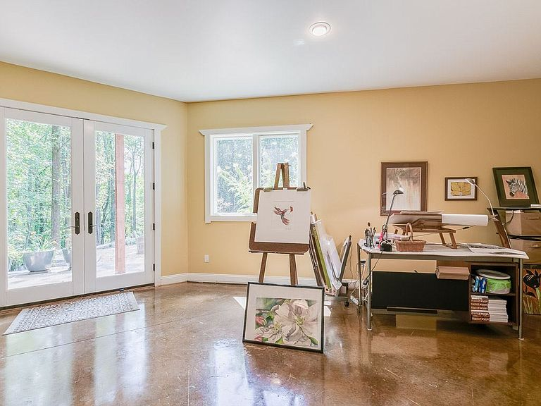 cotw welcome to the octagon light filled studio side of master bedroom with doors to patio