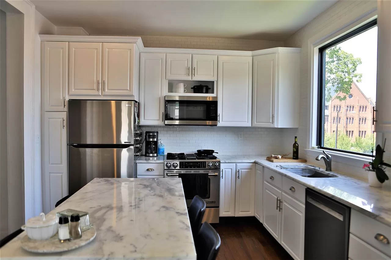 cotw take me to church st kitchen with marble counters and breakfast bar