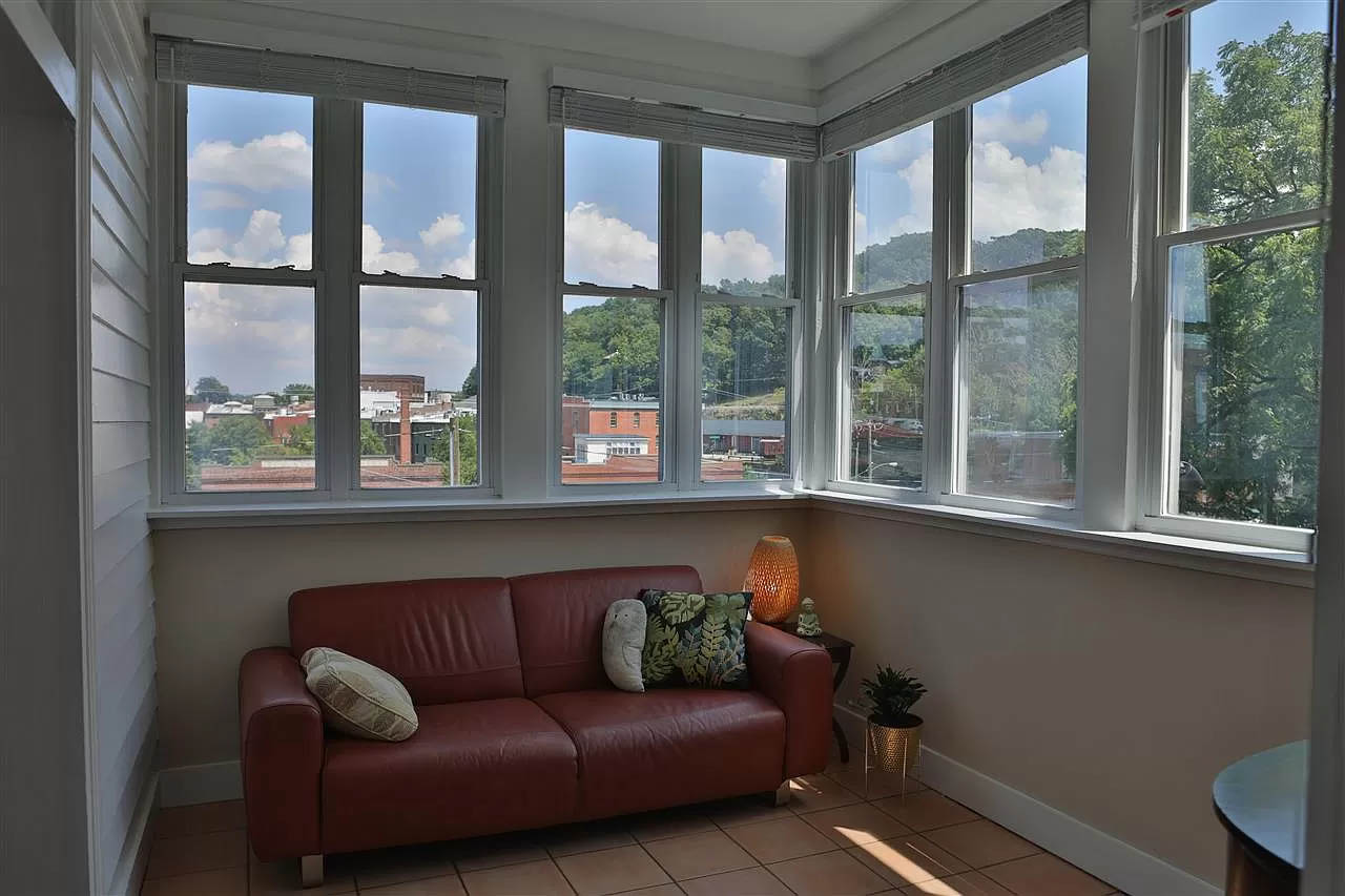 cotw take me to church st back enclosed porch with a downtown view