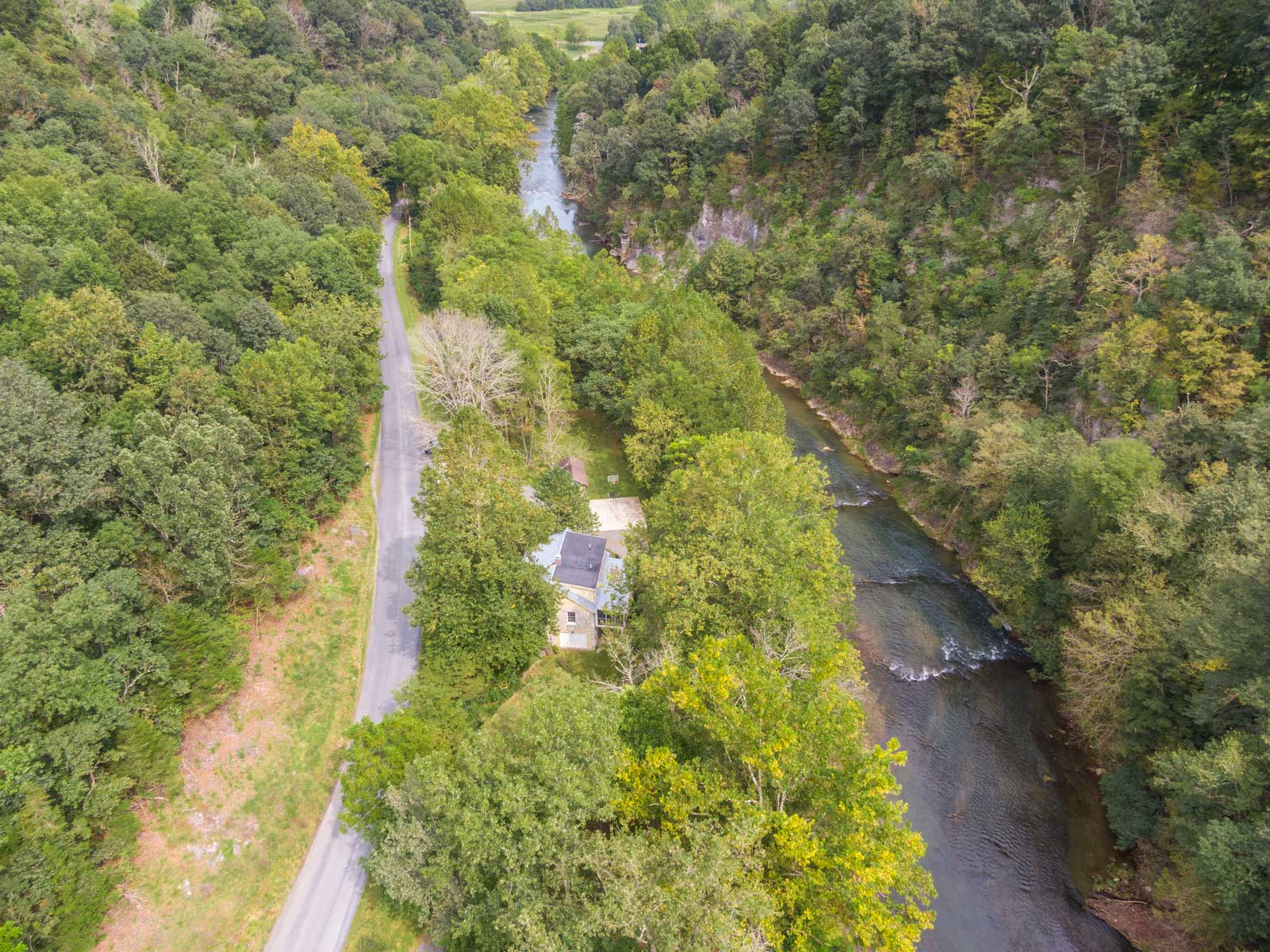 Riverfront retreat drone shot with view of house
