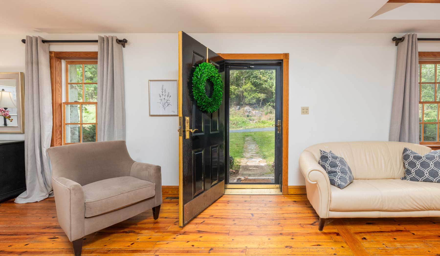 Riverfront retreat entryway with front door open
