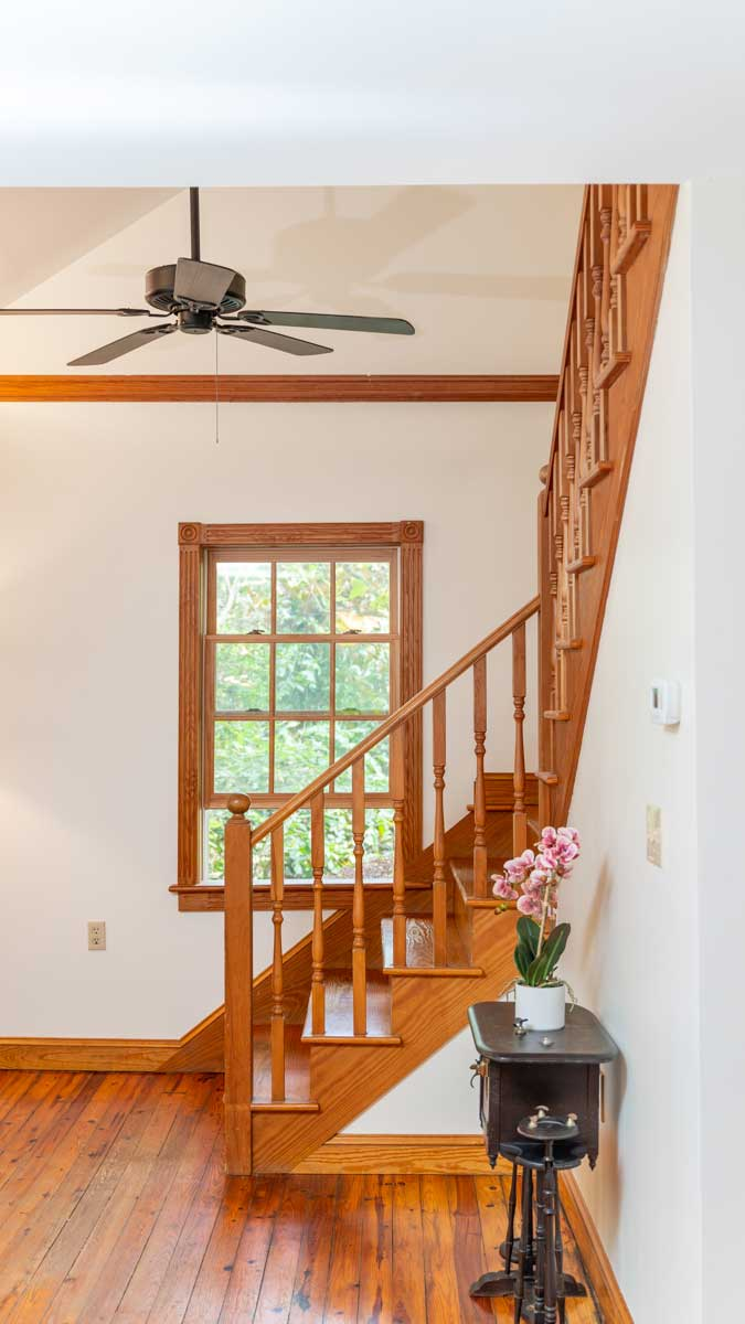 Riverfront retreat winding staircase