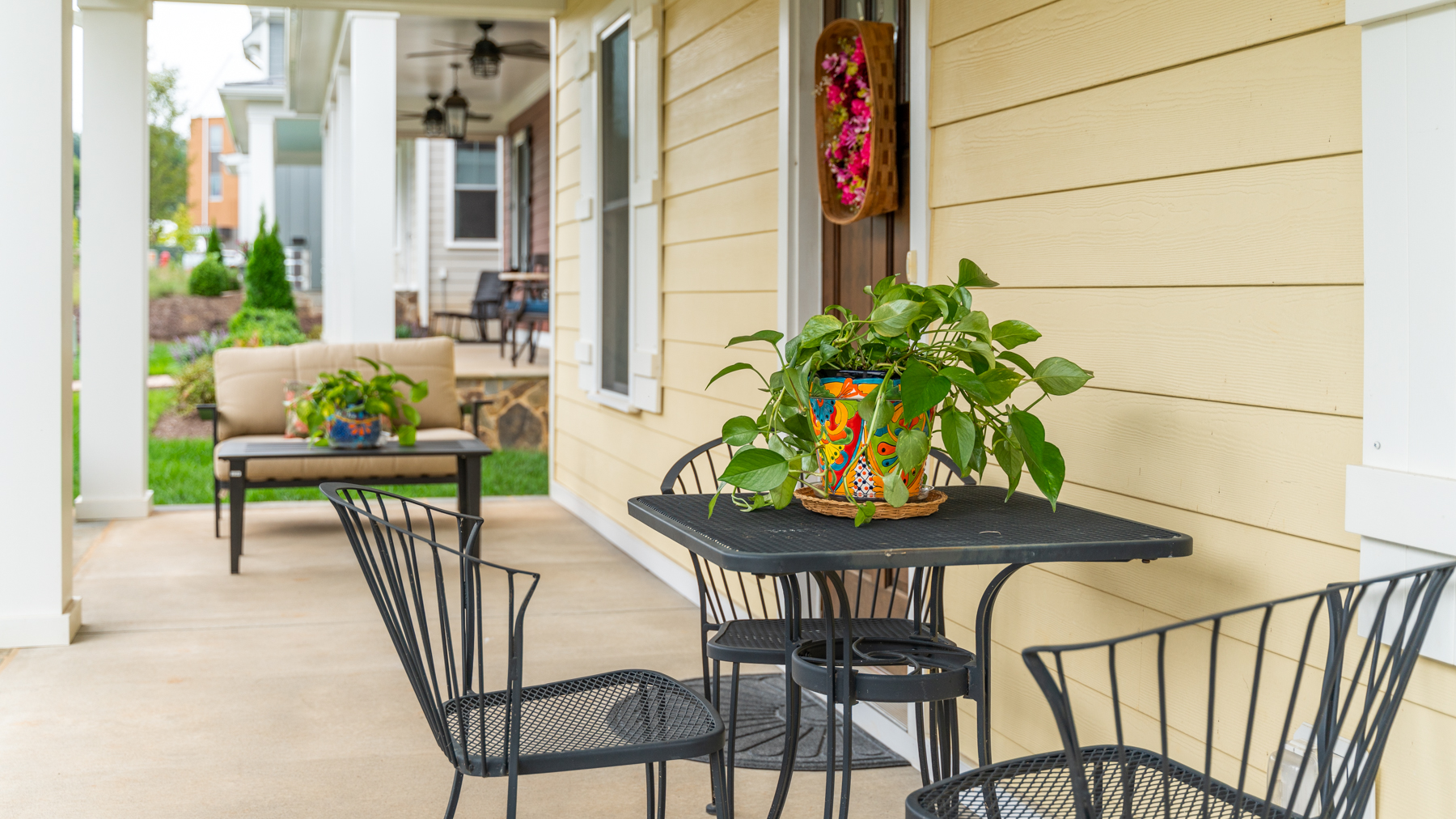 Riverwalk Xing Front porch with table and chairs