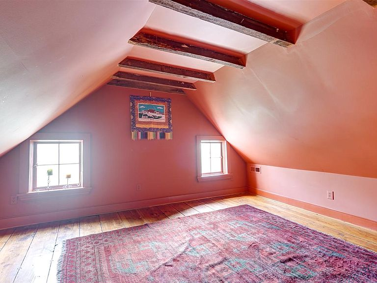 cotw modern antique attic room with beams and wide plank wood floor