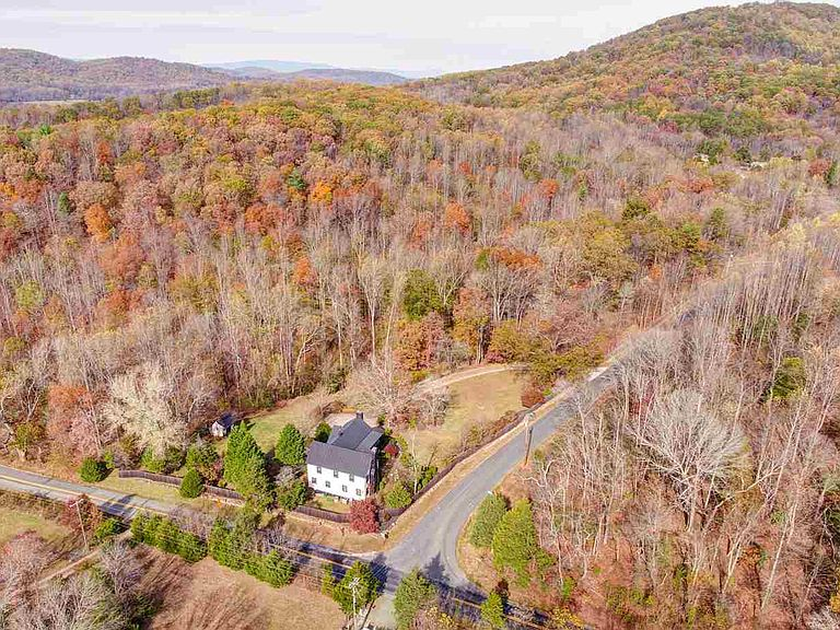 cotw modern antique drone shot of property and mountains