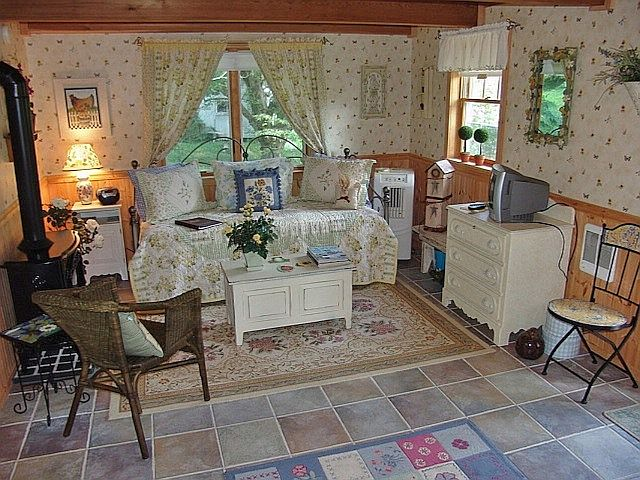 cotw teeny weenie combo living and bedroom with wood stove