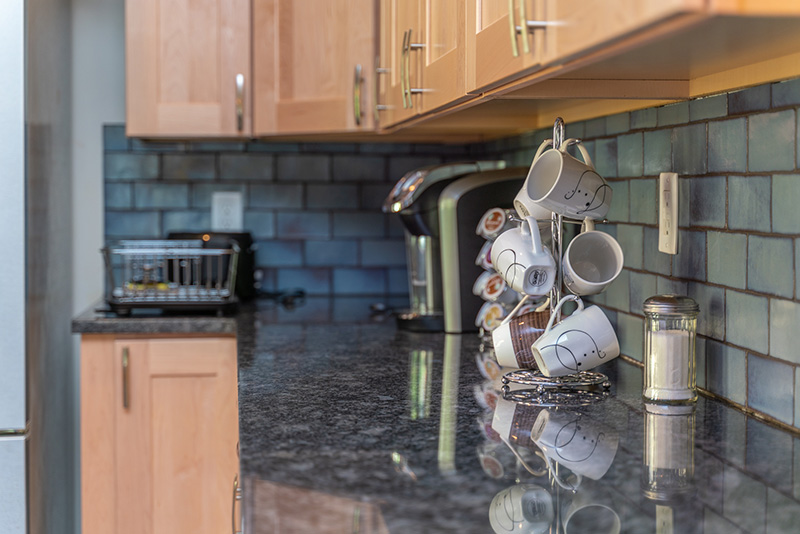 kitchen granite counters and subway tile