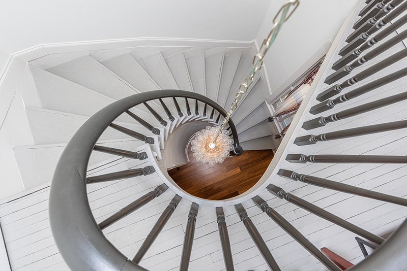 spiral staircase and chandelier from landing