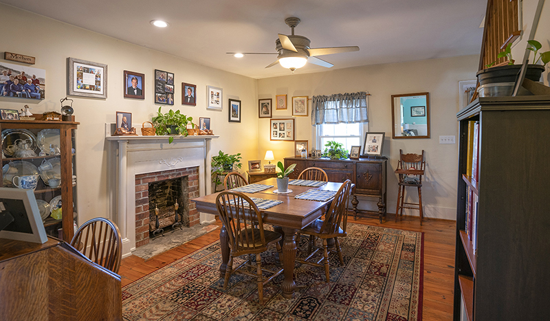 dining room with fireplace and wood floors
