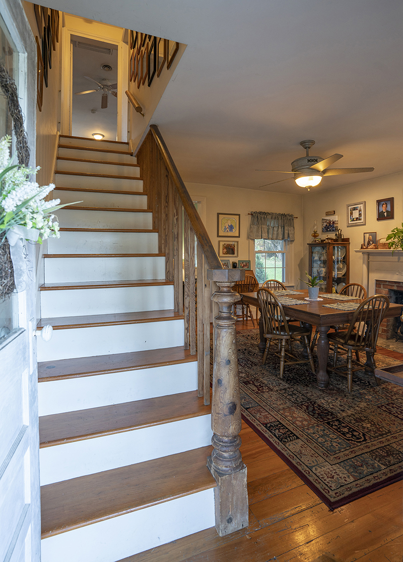 stairway to second floor and dining room