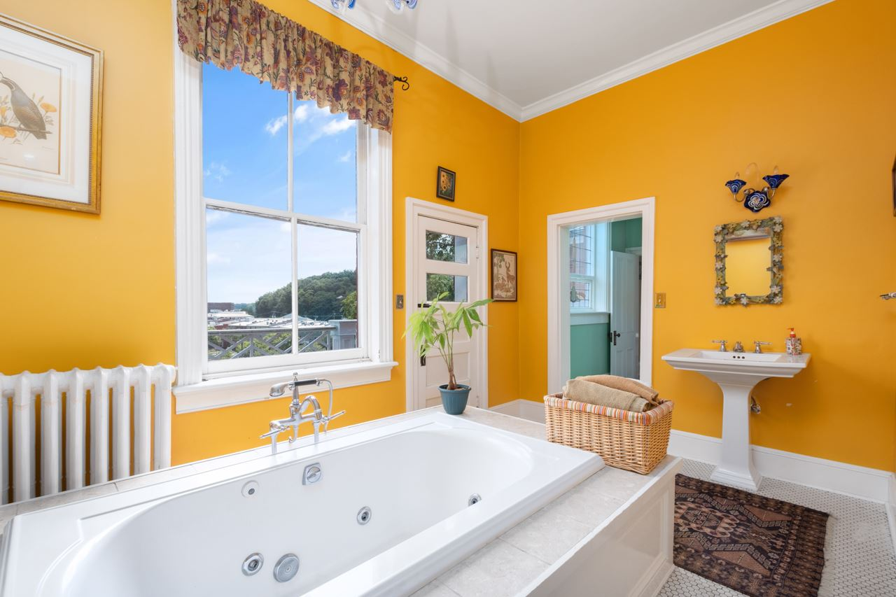 master bath with jetted tub and city view