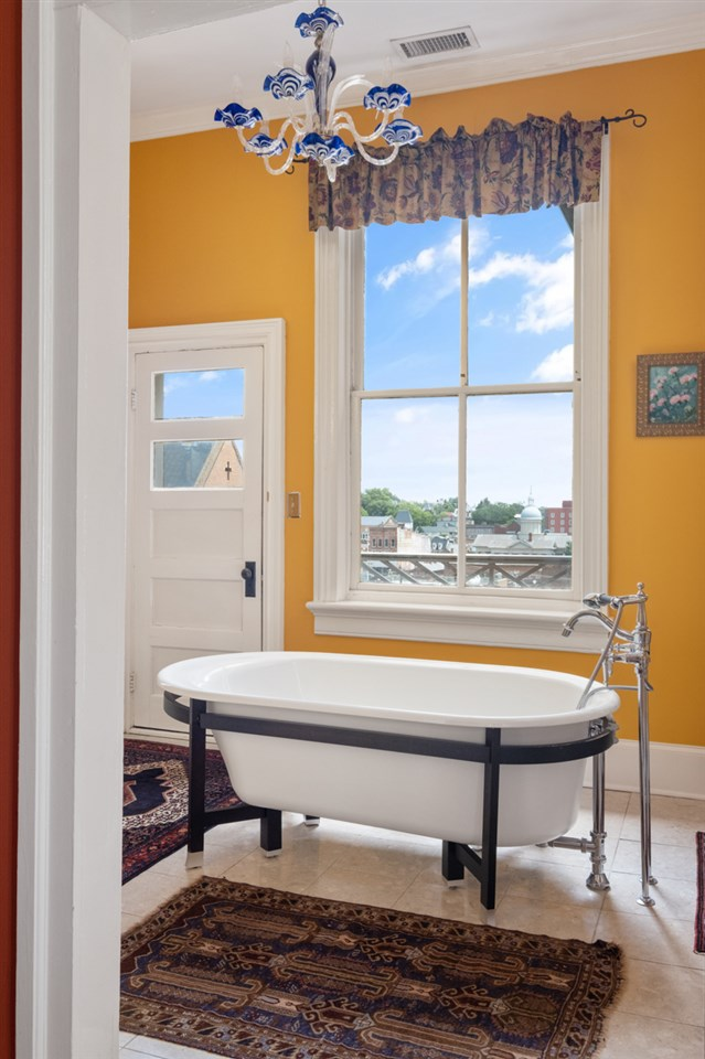 modern claw foot tub with door to balcony