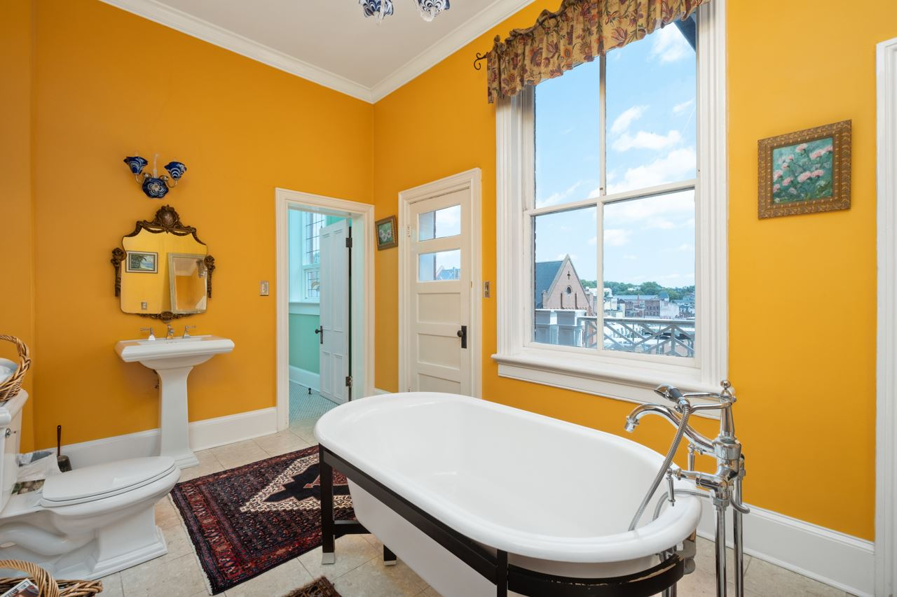 modern clawfoot bathtub and view of city