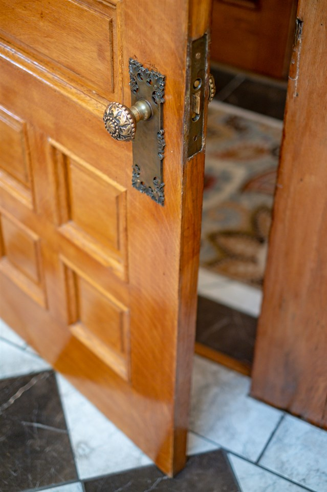 oak doors and marble floor