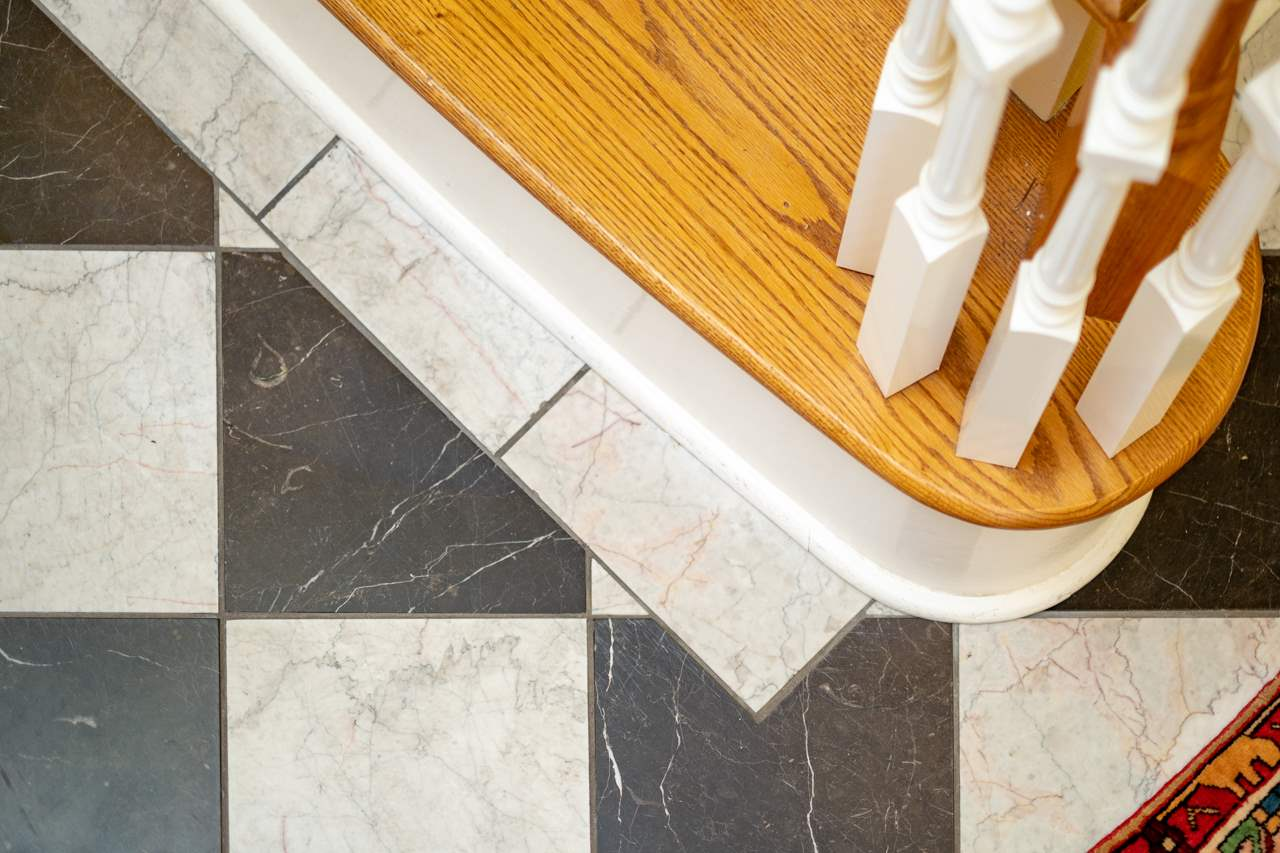oak steps and marble floor