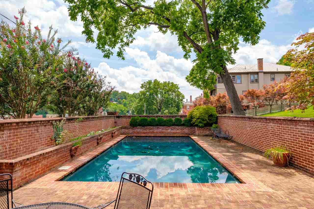 pool with brick patio