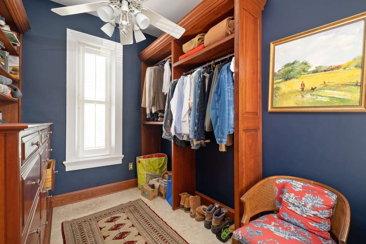 walk in closet with built in shelving