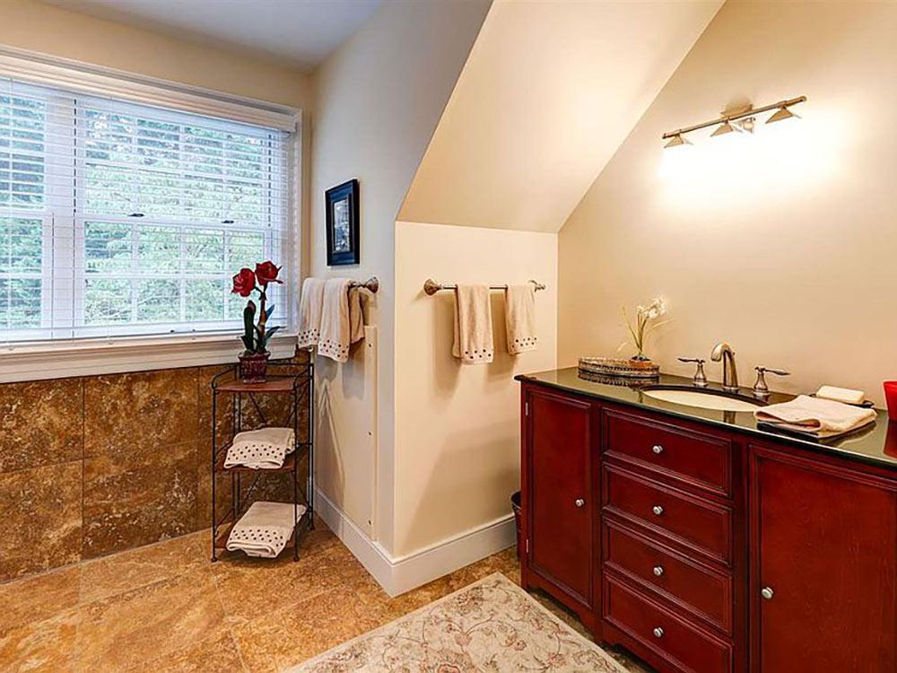 apartment full bath with wood vanity