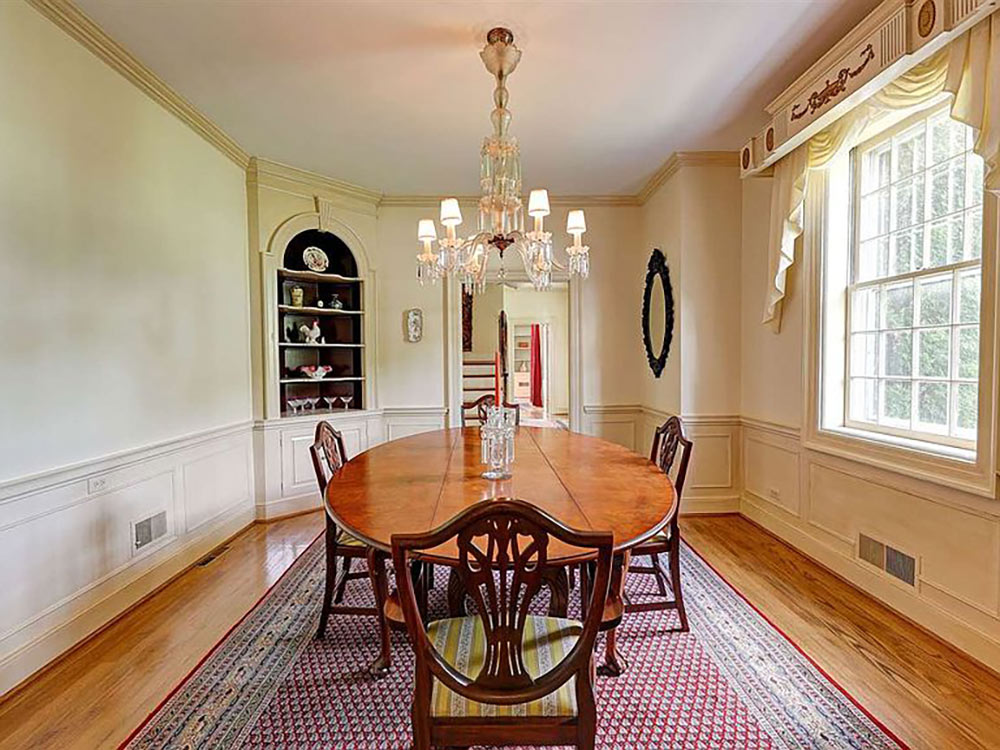formal dining area with built in corner cupboard