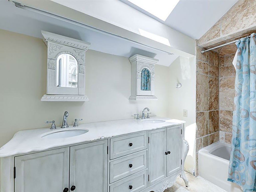 full upstairs bath with skylight and double vanity
