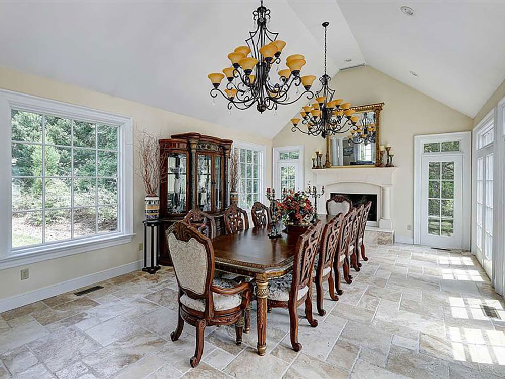 large formal dining room with fireplace